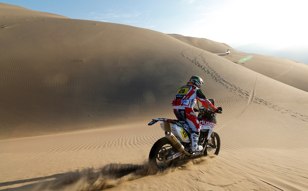 . Husqvarna rider Paulo Goncalves of Portugal competes in the 4nd stage of the 2013 Dakar Rally from Nazca to Arequipa, Peru, Tuesday, Jan. 8, 2013. The race finishes in Santiago, Chile, on Jan. 20. (AP Photo/Victor R. Caivano)