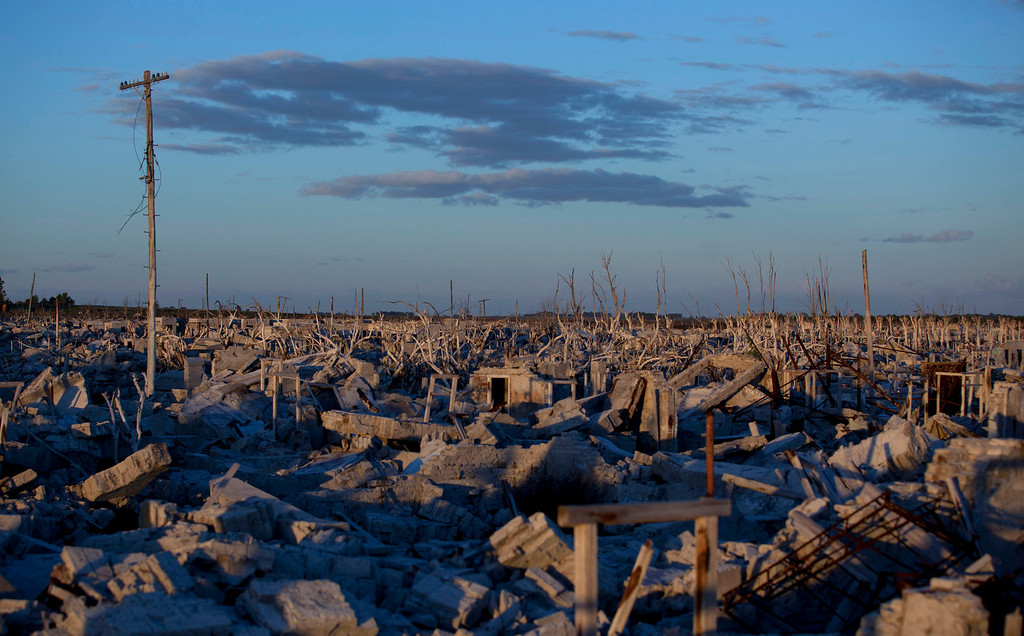 . In this May 6, 2013 photo, buildings lay in ruins in Epecuen,  a village that was once submerged by water in Argentina. Epecuen was once a bustling little lakeside resort, where 1,500 people served 20,000 tourists a season. During Argentina\'s golden age, the same trains that carried grain to the outside world brought visitors from the capital to relax in Epecuen\'s saltwater baths and spas. (AP Photo/Natacha Pisarenko)