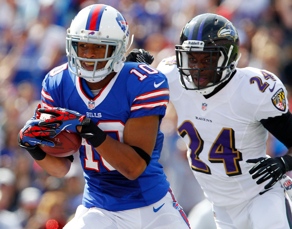 . Buffalo Bills wide receiver Robert Woods (10) scores a touchdown in front of Baltimore Ravens cornerback Corey Graham (24) during the first half of an NFL football game on Sunday, Sept. 29, 2013, in Orchard Park, N.Y. (AP Photo/Bill Wippert)