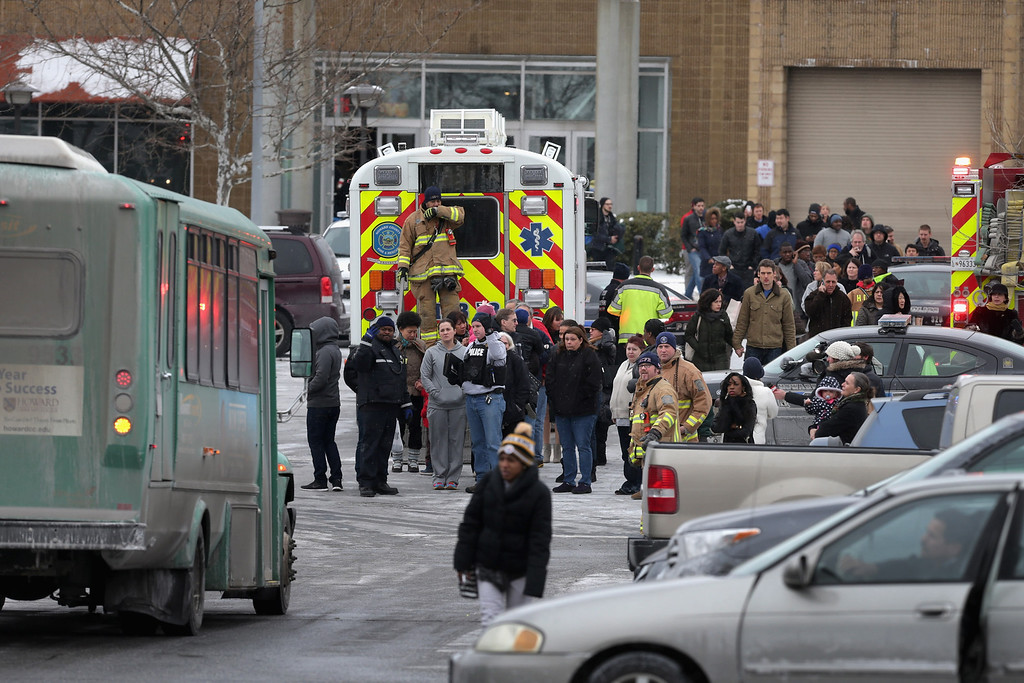 . Police evacuate employees and patrons from the Columbia Town Center Mall after three people were killed in a shooting there January 25, 2014 in Columbia, Maryland. Police still do not have a motive for the shooting but believe the shooter has been killed.  (Photo by Chip Somodevilla/Getty Images)