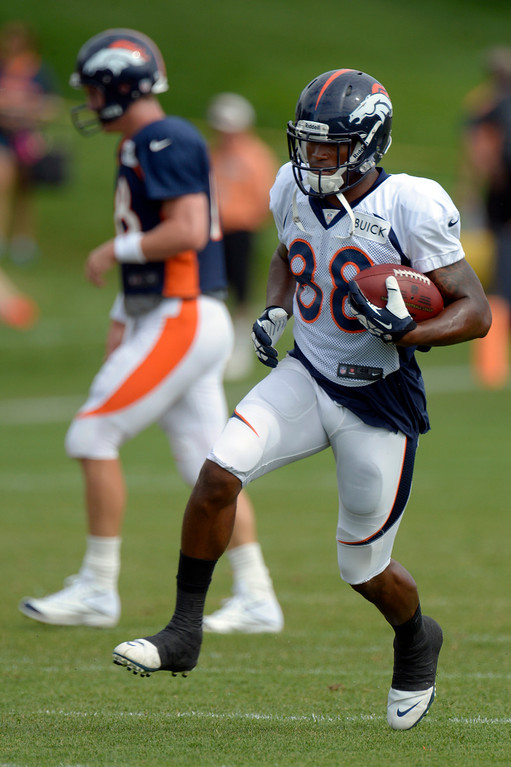 . Denver Broncos WR Demaryius Thomas (88) headd up field after catching a Peyton Manning pass during training camp August 1, 2013 at Dove Valley. (Photo By John Leyba/The Denver Post)