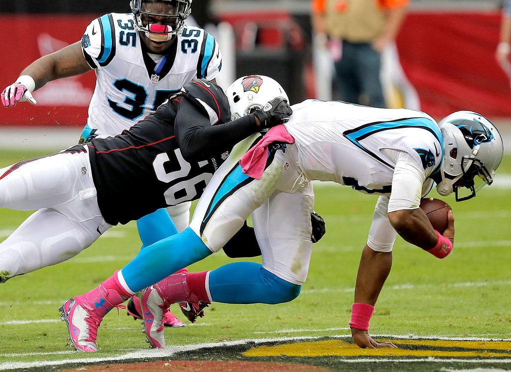 . Carolina Panthers quarterback Cam Newton (1) is sacked by Arizona Cardinals inside linebacker Karlos Dansby (56) during the first half of a NFL football game, Sunday, Oct. 6, 2013, in Glendale, Ariz. (AP Photo/Ross D. Franklin)