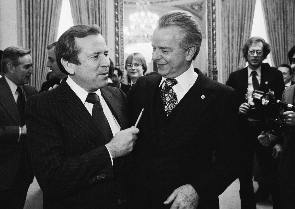 . FILE - This Dec. 4, 1980 file photo shows Senate Majority Leader Robert Byrd of W.Va., right, talking to the man who will replace him, Sen. Howard Baker, R-Tenn., on Capitol Hill in Washington. Baker, who asked what President Richard Nixon knew about Watergate, has died. He was 88. Baker, a Republican, served 18 years in the Senate. He earned the respect of Republicans and Democrats alike and rose to the post of majority leader. He served as White House chief of staff at the end of the Reagan administration and was U.S. ambassador to Japan during President George W. Bush\'s first term.  (AP Photo/Chick Harrity, File)