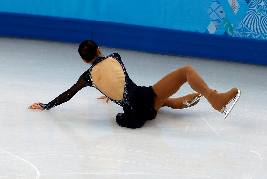 . South Korea\'s Park So-Youn falls as she performs in the Women\'s Figure Skating Free Program at the Iceberg Skating Palace during the Sochi Winter Olympics on February 20, 2014. ADRIAN DENNIS/AFP/Getty Images