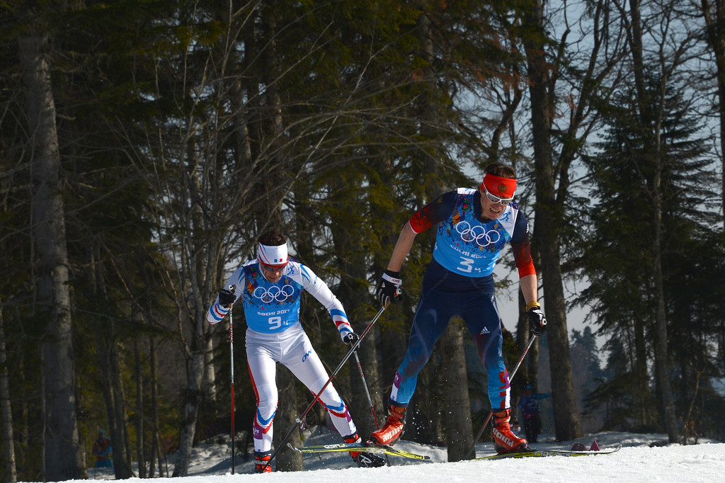 . Russia\'s Maxim Vylegzhanin (R) and France\'s Ivan Perrillat Boiteux compete in the Men\'s Cross-Country Skiing 4 x 10km Relay at the Laura Cross-Country Ski and Biathlon Center during the Sochi Winter Olympics on February 16, 2014 in Rosa Khutor near Sochi. KIRILL KUDRYAVTSEV/AFP/Getty Images