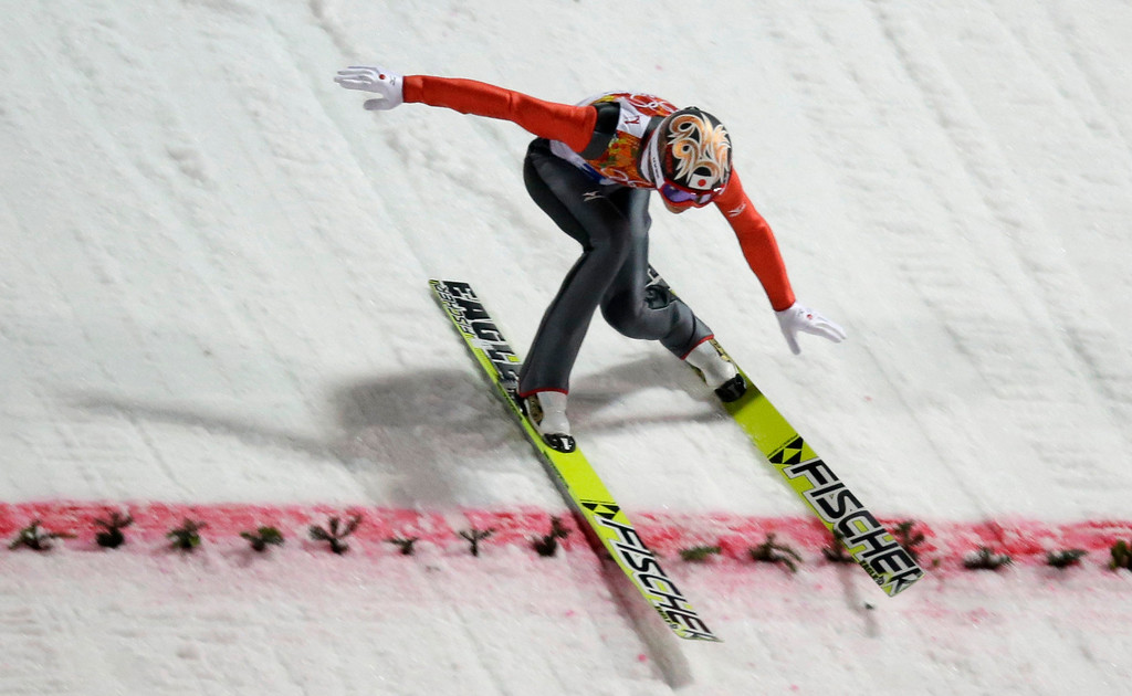 . Japan\'s Taku Takeuchi lands his first attempt during the men\'s normal hill ski jumping final at the 2014 Winter Olympics, Sunday, Feb. 9, 2014, in Krasnaya Polyana, Russia. (AP Photo/Gregorio Borgia)