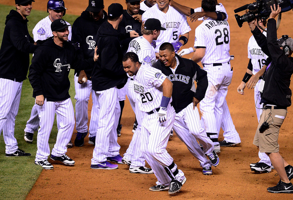 . DENVER, CO - MAY 21: Wilin Rosario (20) of the Colorado Rockies celebrates his walk-off single with teammates during the Rockies\' 5-4 win at Coors Field. The Arizona Diamondbacks visited the Colorado Rockies. (Photo by AAron Ontiveroz/The Denver Post)