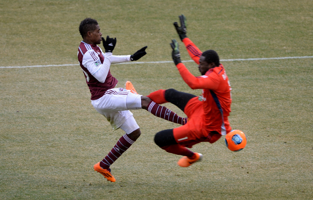 . COMMERCE CITY MARCH 22: Deshorn Brown of Colorado Rapids (26) and Donovan Ricketts of Portland Timbers (1) collide in the 2nd half of the game at Dick\'s Sporting Goods Park. Commerce City, Colorado. March 22. 2014. Colorado won 2-0. (Photo by Hyoung Chang/The Denver Post)