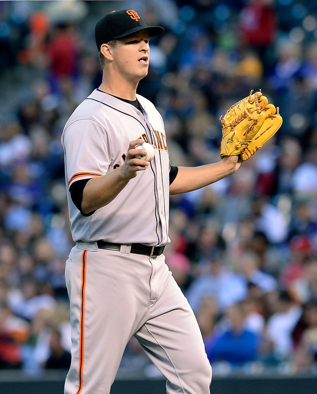 . Giants starting pitcher Matt Cain gestured to the San Francisco dugout that he was ok in the third inning. The Colorado Rockies hosted the San Francisco Giants Wednesday night, May 21, 2014.  (Photo by Karl Gehring/The Denver Post)