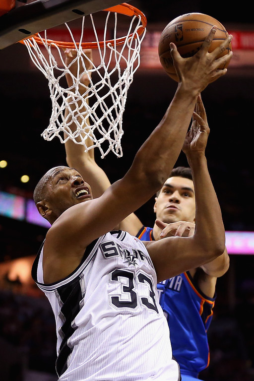 . Boris Diaw #33 of the San Antonio Spurs drives to the basket against Steven Adams #12 of the Oklahoma City Thunder in the second quarter during Game Five of the Western Conference Finals of the 2014 NBA Playoffs at AT&T Center on May 29, 2014 in San Antonio, Texas.   (Photo by Ronald Martinez/Getty Images)