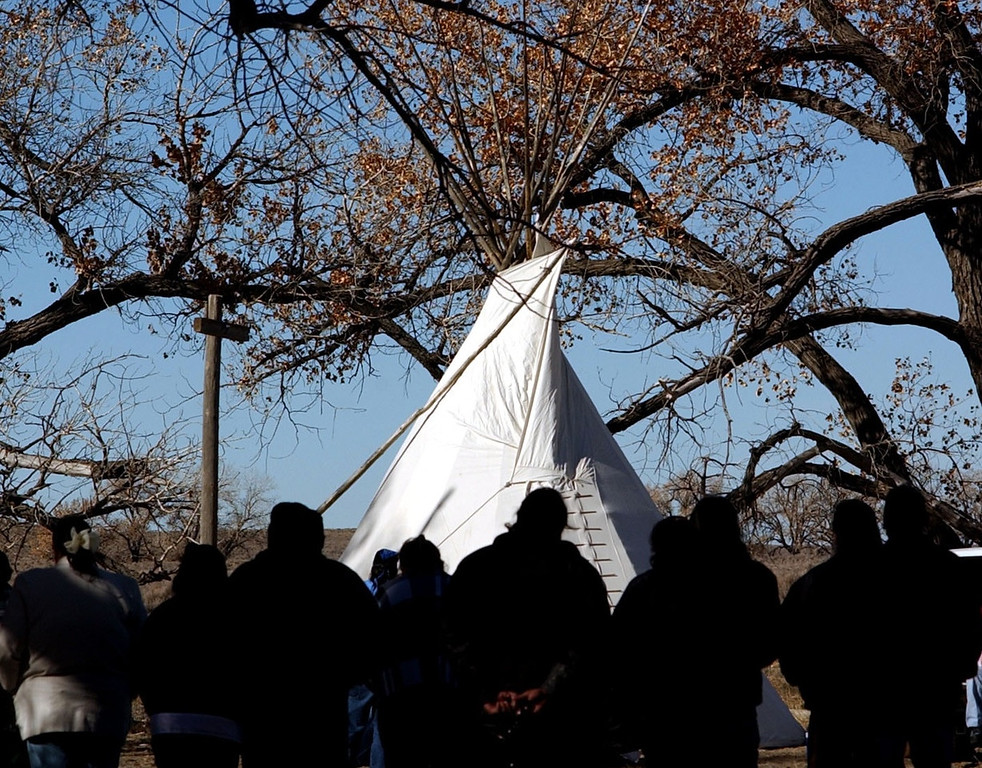 . Tribal members pray outside a tepee Thursday, Nov. 28, 2002 for the victims of the 1864 Sand Creek massacre. (The Denver Post/ Hyoung Chang)
