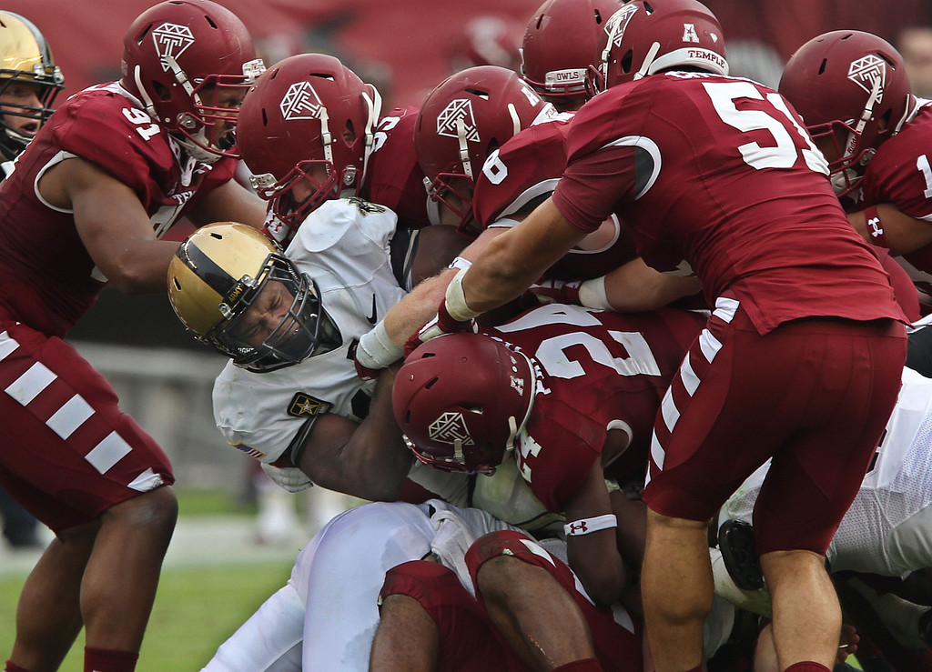 . Temple\'s defense swarms around Army\'s Larry Dixon, center, who is stopped for no gain in the third quarter of an NCAA college football game Saturday, Oct. 19, 2013, in Philadelphia. Temple won 33-14. (AP Photo/Philadelphia Inquirer, Michael Bryant)