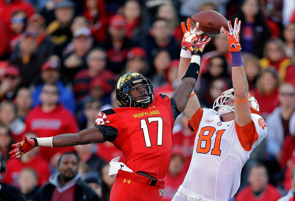 . Clemson tight end Stanton Seckinger (81) can\'t hold onto a pass as he is pressured by Maryland defensive back Isaac Goins in the first half of an NCAA college football game in College Park, Md., Saturday, Oct. 26, 2013. (AP Photo/Patrick Semansky)