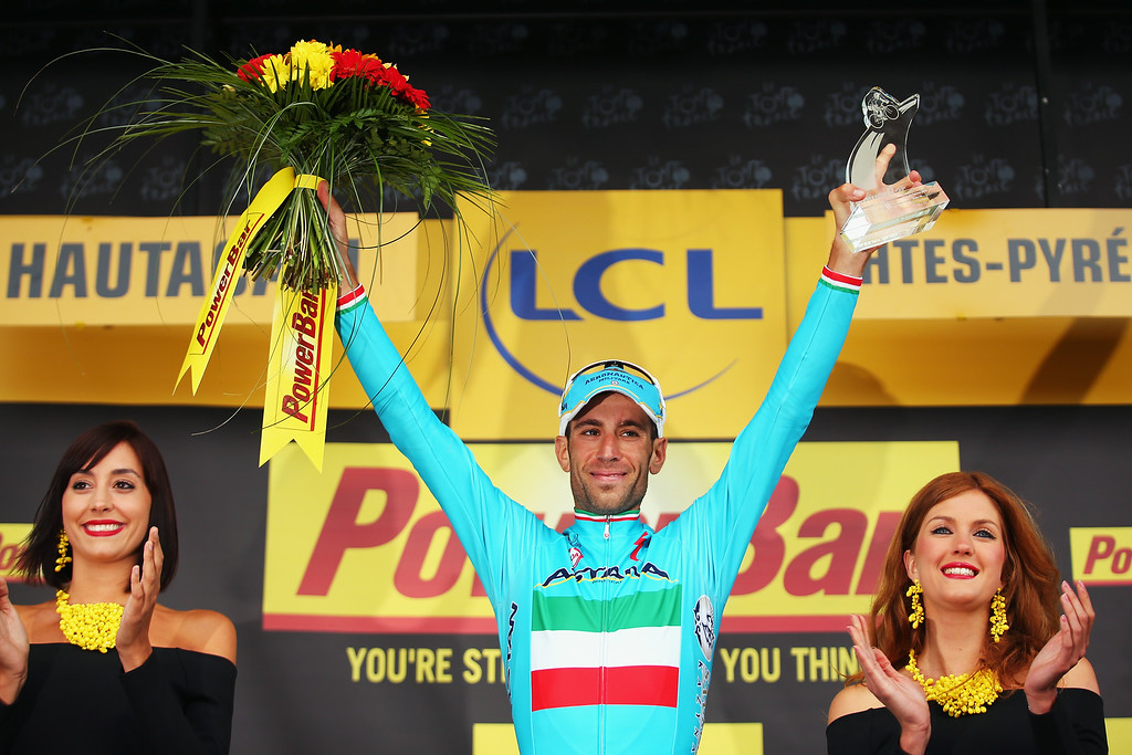 . Vincenzo Nibali of Italy and Astana Pro Cycling celebrates winning the eighteenth stage of the 2014 Tour de France, a 146km stage between Pau and Hautacam, on July 24, 2014 in Hautacam, France.  (Photo by Bryn Lennon/Getty Images)