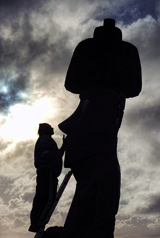. A worker repairs a Moais -- stone statue of the Rapa Nui culture -- on Easter Island, 3700 km off the Chilean coast in the Pacific Ocean, on July 9, 2010.   MARTIN BERNETTI/AFP/Getty Images
