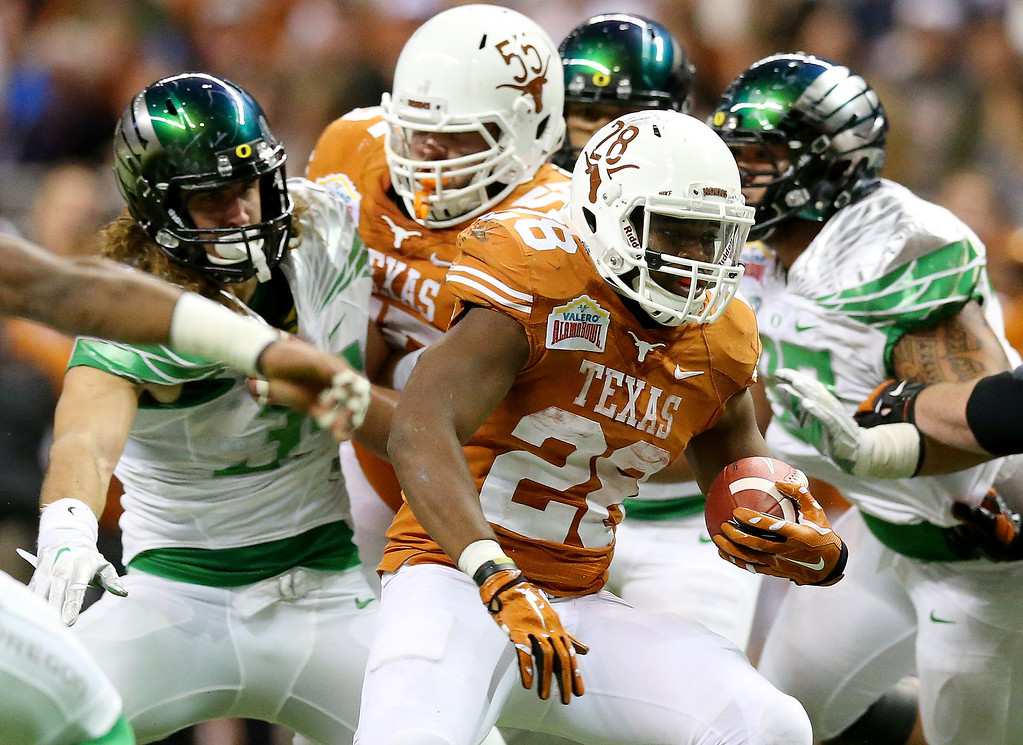 . Running back Malcolm Brown #28 of the Texas Longhorns carries the ball against the Oregon Ducks during the Valero Alamo Bowl at the Alamodome on December 30, 2013 in San Antonio, Texas.  (Photo by Ronald Martinez/Getty Images)