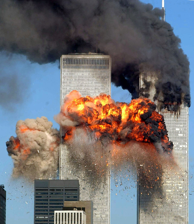 . Hijacked United Airlines Flight 175 from Boston crashes into the south tower of the World Trade Center and explodes at 9:03 a.m. on September 11, 2001 in New York City.  (Photo by Spencer Platt/Getty Images)