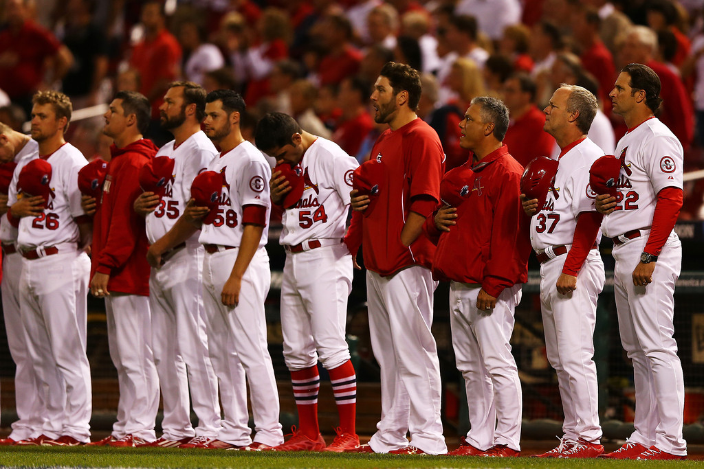 . The St. Louis Cardinals take part in pre-game ceremonies for Game Five of the National League Division Series against the Pittsburgh Pirates at Busch Stadium on October 9, 2013 in St Louis, Missouri.  (Photo by Elsa/Getty Images)