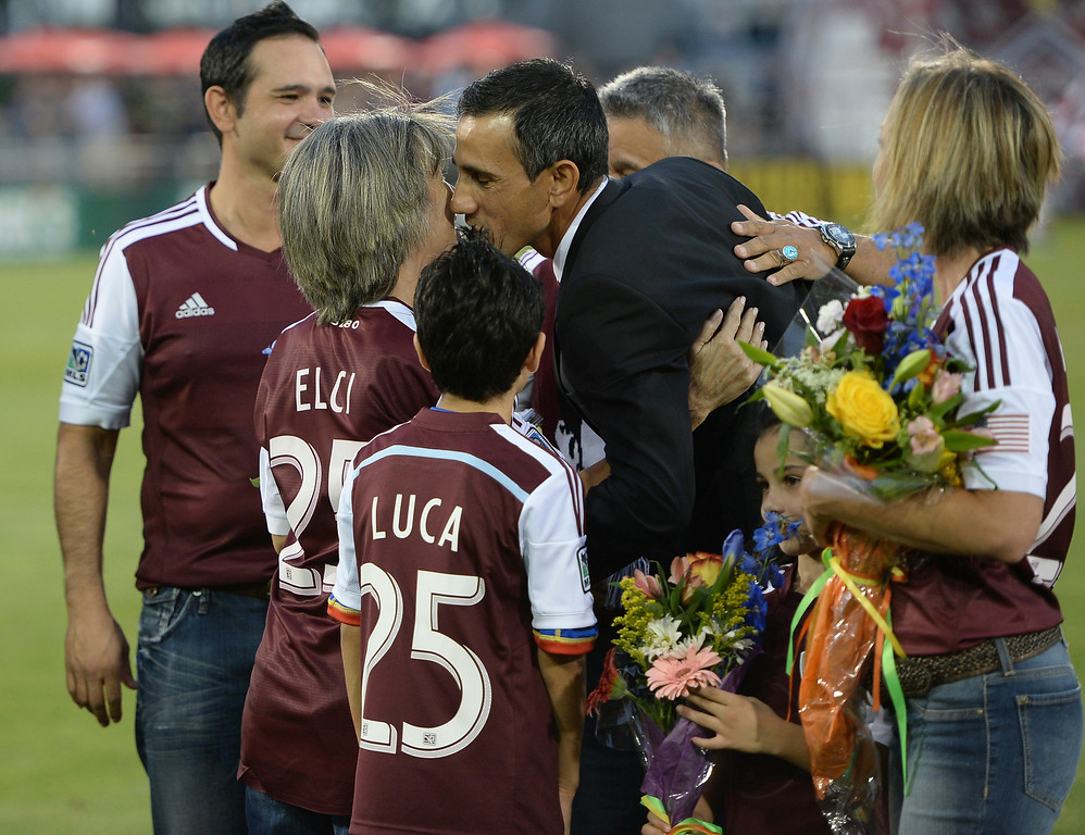 . Colorado coach Pablo Mastroeni shared a kiss with his mother as he was honored with s spot on the team\'s gallery of honor at the stadium Friday night. The Colorado Rapids hosted Chivas USA at Dick\'s Sporting Goods Park Friday night, July 25, 2014. Photo by Karl Gehring/The Denver Post