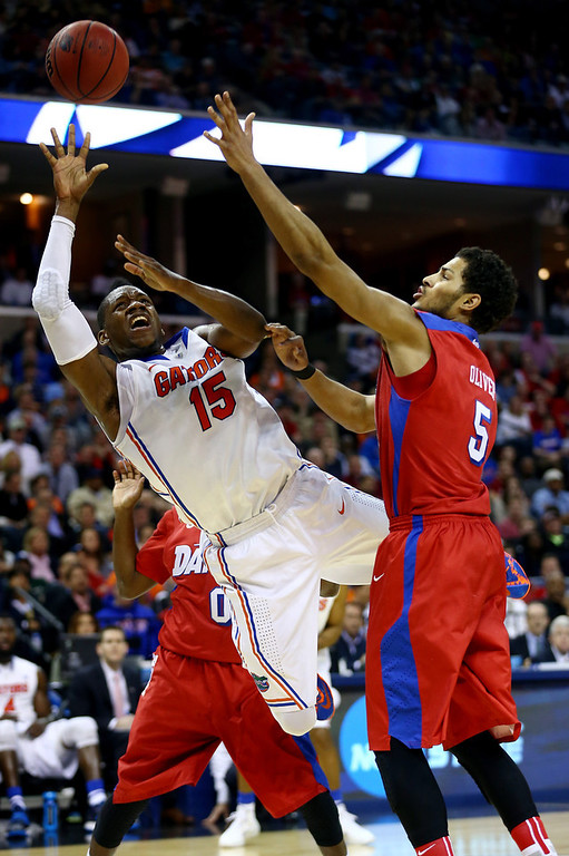 . Will Yeguete #15 of the Florida Gators goes up for a shot as Devin Oliver #5 of the Dayton Flyers defends during the south regional final of the 2014 NCAA Men\'s Basketball Tournament at the FedExForum on March 29, 2014 in Memphis, Tennessee.  (Photo by Streeter Lecka/Getty Images)