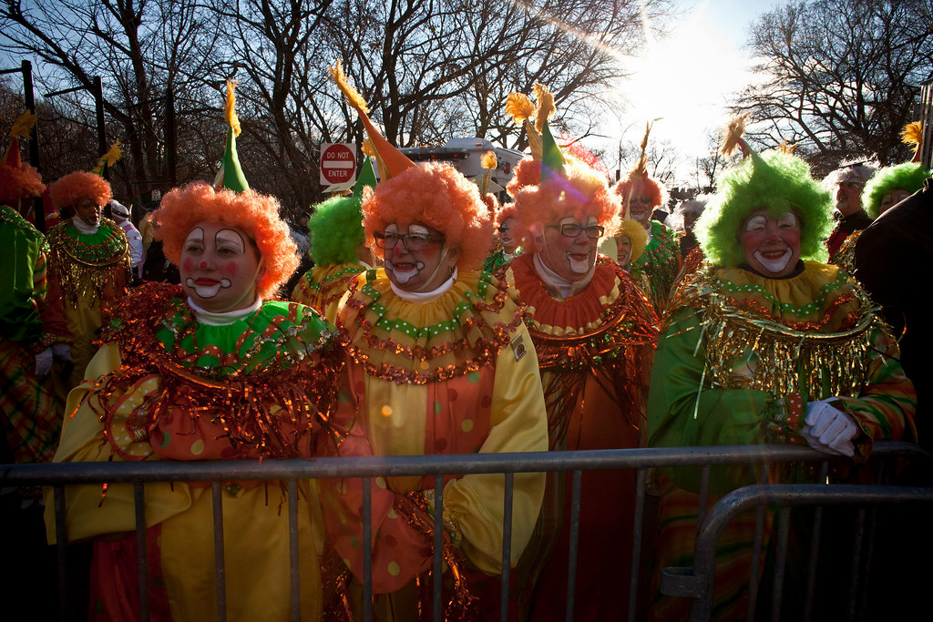 . People dressed as clowns attend the Macy\'s Thanksgiving Day Parade on November 28, 2013 in New York City. Despite earlier concerns about the wind, the balloons flew as planned for the parade. (Photo by Kena Betancur/Getty Images)