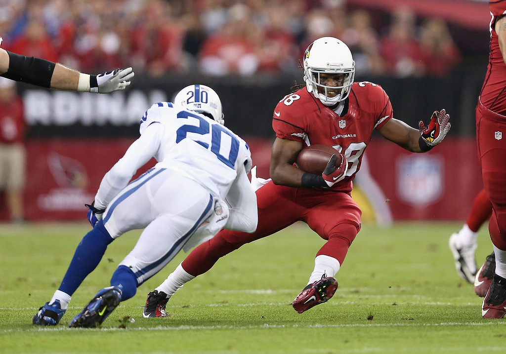 . Running back Andre Ellington #38 of the Arizona Cardinals rushes the football against free safety Darius Butler #20 of the Indianapolis Colts during the NFL game at the University of Phoenix Stadium on November 24, 2013 in Glendale, Arizona.  (Photo by Christian Petersen/Getty Images)