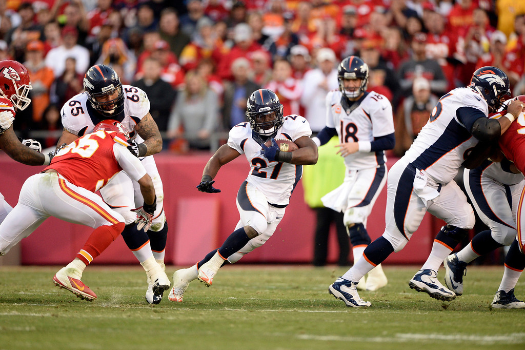 . KANSAS CITY, MO - DECEMBER 01: Denver Broncos running back Knowshon Moreno (27) finds a hole in the Kansas City Chiefs defense during the second quarter December 1, 2013 at Arrowhead Stadium.  (Photo by John Leyba/The Denver Post)