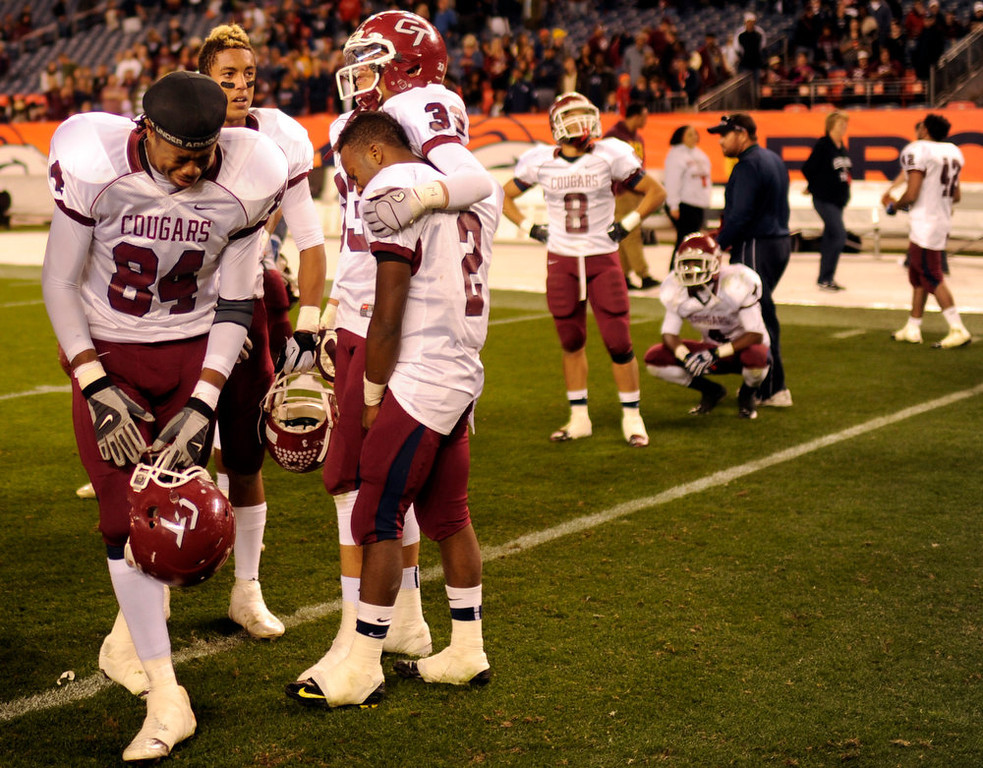 . Cherokee Trail TE Devin Arnold (84), left, and teammates show emotion after losing the 5A State Championship game against Valor Christian at Sports Authority Field at Mile High on Saturday in Denver, CO on December 1, 2012. Hyoung Chang, The Denver Post