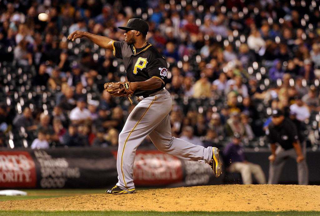 . DENVER, CO. - AUGUST 09: Pirates infielder Josh Harrison was installed as a relief pitcher to face Colorado batter Corey Dickerson in the eighth inning. The Colorado Rockies defeated the Pittsburgh Pirates 10-1 Friday night, August 9, 2013. Photo By Karl Gehring/The Denver Post