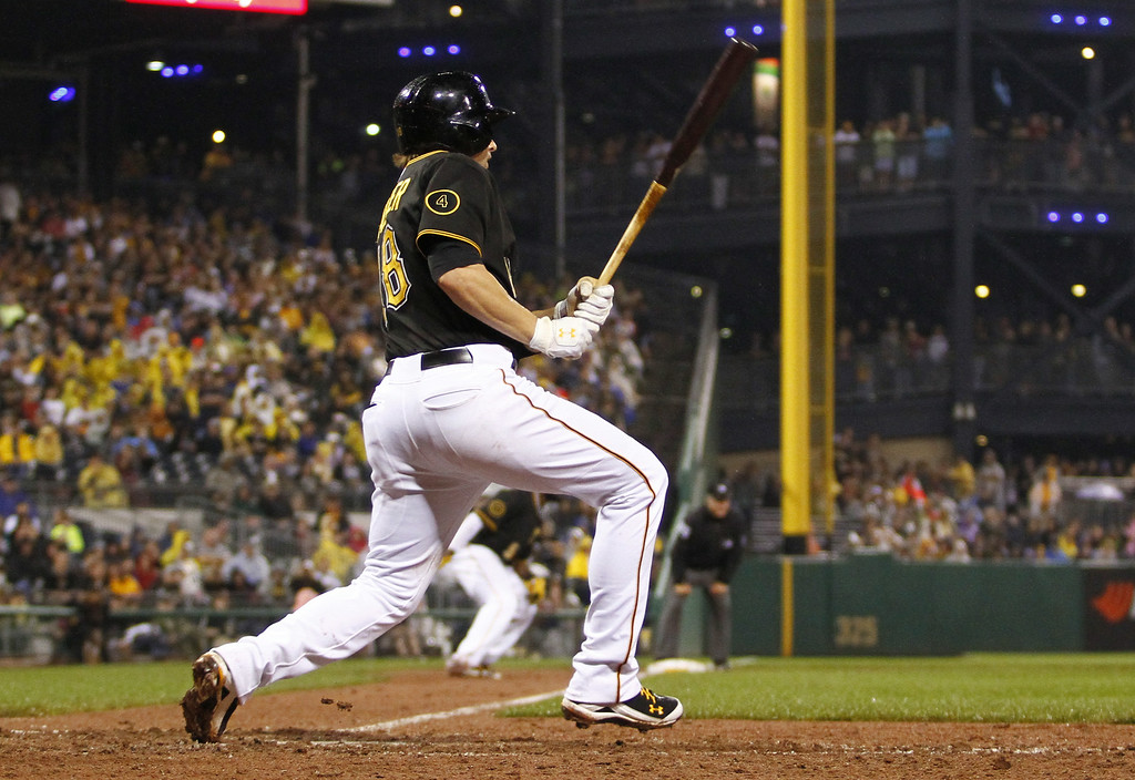 . PITTSBURGH, PA - JULY 19: Neil Walker #18 of the Pittsburgh Pirates hits a RBI single in the eighth inning against the Colorado Rockies during the game at PNC Park July 19, 2014 in Pittsburgh, Pennsylvania. (Photo by Justin K. Aller/Getty Images)