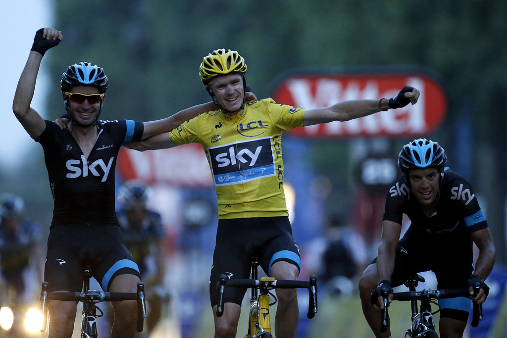 . Tour de France 2013 winner Britain\'s Christopher Froome (C) celebrates with team mate Spain\'s David Lopez Garcia (L) and Australia\'s Richie Porte on the Champs-Elysee avenue in Paris, after crossing the finish line of the 133.5 km twenty-first and last stage of the 100th edition of the Tour de France cycling race on July 21, 2013 between Versailles and Paris.  PASCAL GUYOT/AFP/Getty Images