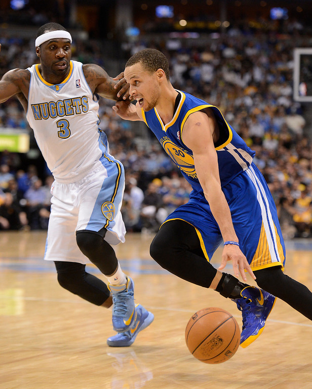 . Golden State Warriors point guard Stephen Curry (30) drives to the basket against Denver Nuggets point guard Ty Lawson (3). The Denver Nuggets took on the Golden State Warriors in Game 5 of the Western Conference First Round Series at the Pepsi Center in Denver, Colo. on April 30, 2013. (Photo by John Leyba/The Denver Post)