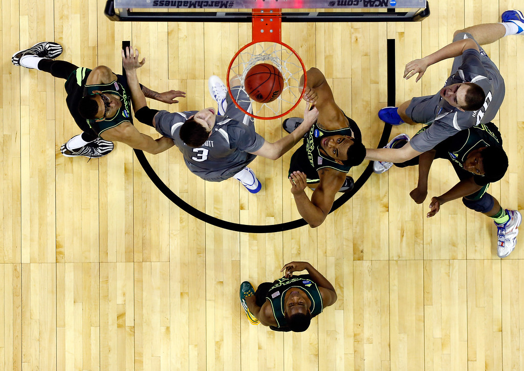 . Rico Gathers #2 of the Baylor Bears and Doug McDermott #3 of the Creighton Bluejays watch a shot go in during the third round of the 2014 NCAA Men\'s Basketball Tournament at the AT&T Center on March 23, 2014 in San Antonio, Texas.  (Photo by Tom Pennington/Getty Images)