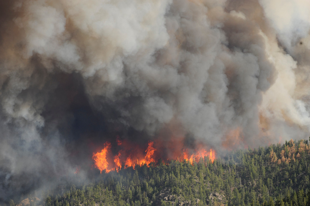 . Flames were visible from the area near Larimer County Road 27 and Colorado Hwy 14 of the High Park fire west of Fort Collins on Saturday, June 9, 2012.  The fire has burned an estimated two- to three-thousand acres. Karl Gehring/The Denver Post