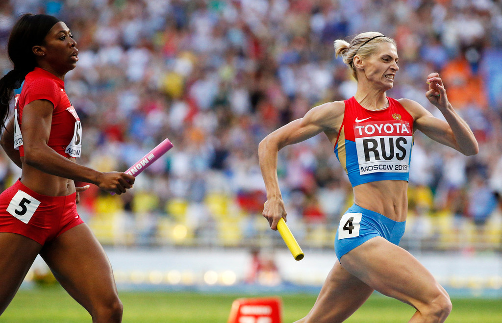 . Russia\'s Antonina Krivoshapka, right, powers ahead of United States\' Francena McCorory on her way to winning the women\'s 4x400-meter relay final at the World Athletics Championships in the Luzhniki stadium in Moscow, Russia, Saturday, Aug. 17, 2013. (AP Photo/Alexander Zemlianichenko)