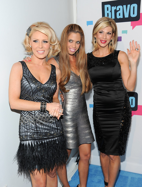 ". ""The Real Housewives of Orange County\"" cast members, from left, Gretchen Rossi, Lydia McLaughlin and Alexis Bellino attend the Bravo Network 2013 Upfront on Wednesday April 3, 2013 in New York. (Photo by Evan Agostini/Invision/AP)"