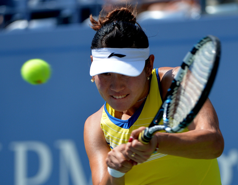 . Ying-Ying Duan of China returns a shot to Caroline Wozniacki of Denmark during their 2013 US Open women\'s singles match at the USTA Billie Jean King National Tennis Center August 27, 2013 in New York. STAN HONDA/AFP/Getty Images