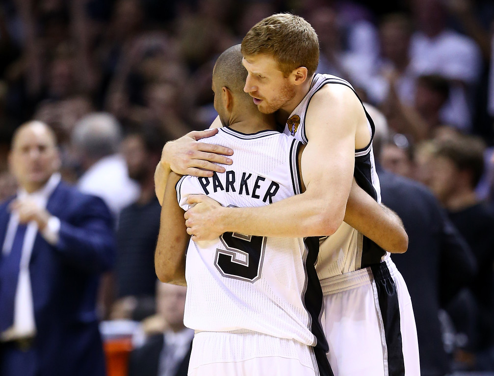 . Matt Bonner #15 and Tony Parker #9 of the San Antonio Spurs celebrate against the Miami Heat during Game Five of the 2014 NBA Finals at the AT&T Center on June 15, 2014 in San Antonio, Texas.   (Photo by Andy Lyons/Getty Images)