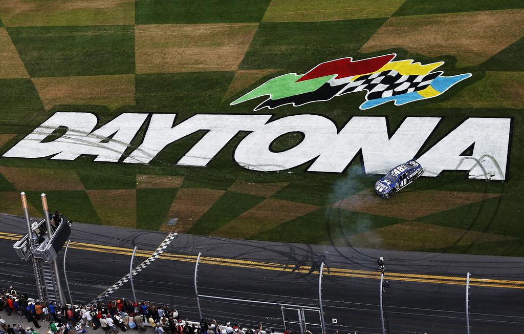 . Jimmie Johnson, driver of the #48 Lowe\'s Chevrolet, celebrates winning the NASCAR Sprint Cup Series Daytona 500 at Daytona International Speedway on February 24, 2013 in Daytona Beach, Florida.  (Photo by Jonathan Ferrey/Getty Images)
