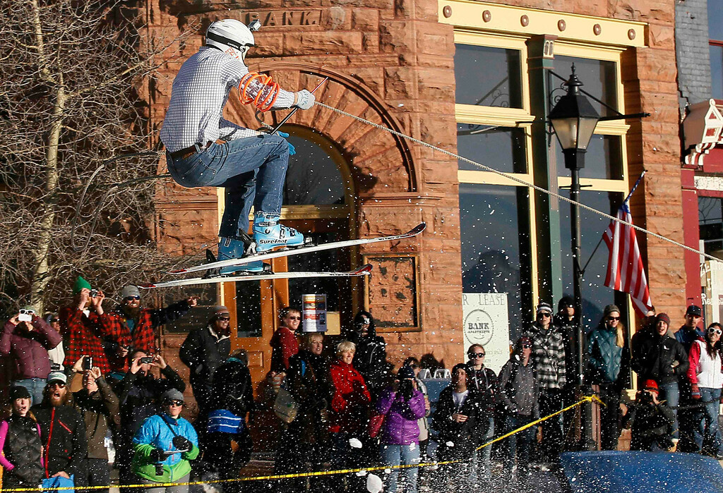 . A skier, who is pulled by a horse, flies off a jump in the snow-covered main street during the annual ski joring race in downtown Leadville, Colorado March 2, 2013. This was the 62nd year for the competition in Leadville. REUTERS/Rick Wilking
