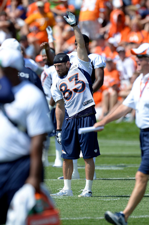 . Denver Broncos WR Wes Welker (83) stretches during training camp July 26, 2013 at Dove Valley. (Photo By John Leyba/The Denver Post)