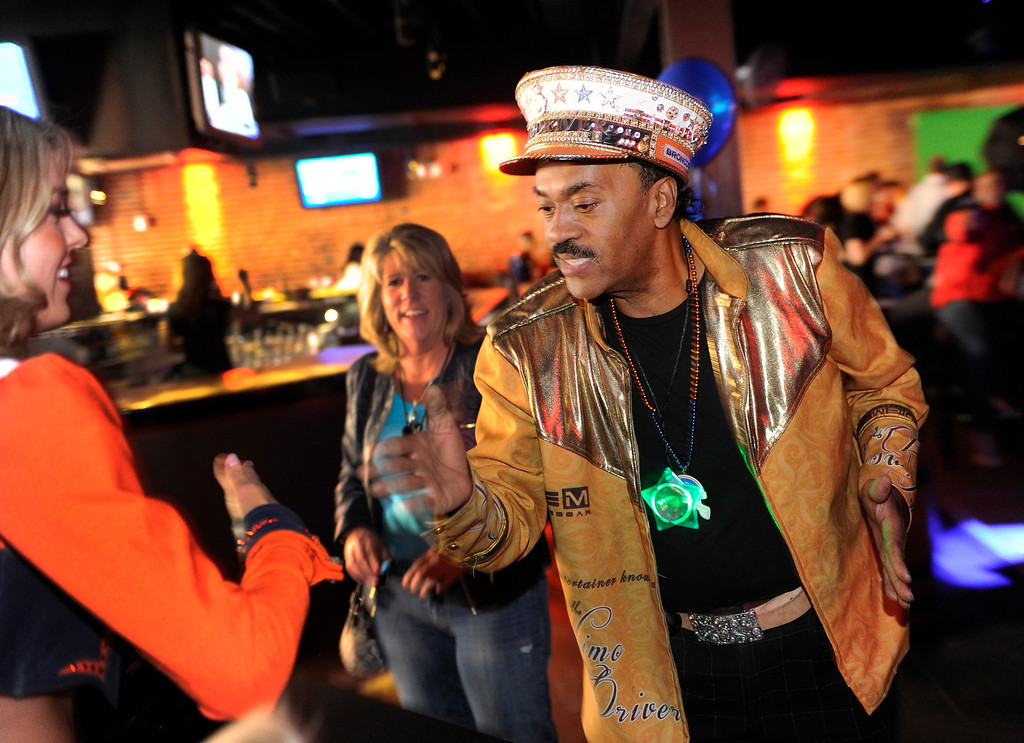 . Broncos Super Fan Ralph Williams taught the Denver Broncos Cheerleaders a signature move Thursday night. Fans gathered for a NFL draft party at the Tavern Downtown, 1949 Market Street, Thursday night, April 25, 2013. Photo By Karl Gehring/The Denver Post