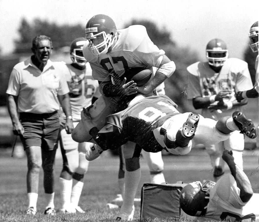 . Aug, 16, 1982: Linebacker Tom Hall made a tackle against Bob Stephenson during Broncos camp. (Seth Perlman, The Denver Post)