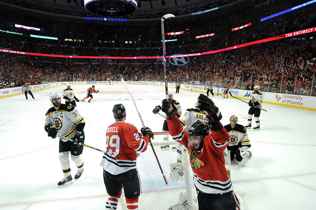. CHICAGO, IL - JUNE 22:  Jonathan Toews #19 celebrates his teammate Patrick Kane (not pictured) #88 of the Chicago Blackhawks goal in the first period against Tuukka Rask #40 of the Boston Bruins in Game Five of the 2013 NHL Stanley Cup Final at United Center on June 22, 2013 in Chicago, Illinois.  (Photo by HH/Getty Images)