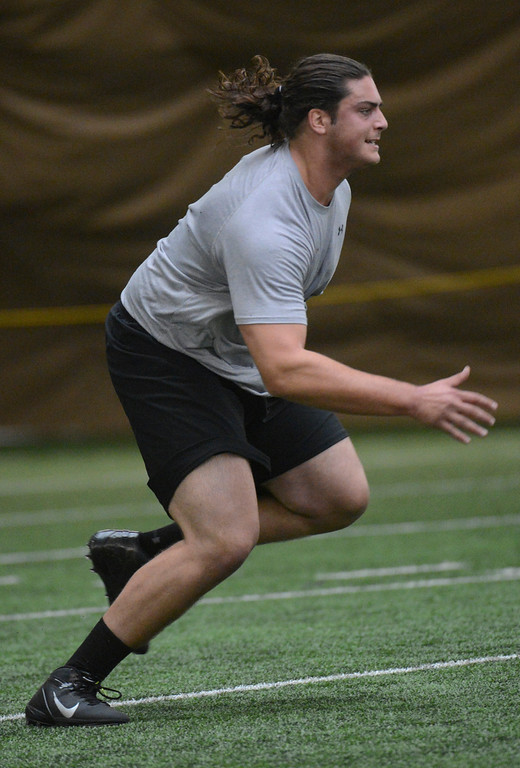 . BOULDER, CO. - MARCH 13: David Bakhtiari preforms drills during pro days, March, 13, 2013. NFL scouts gathered to watch players at the University of Colorado in Boulder. (Photo By RJ Sangosti/The Denver Post)