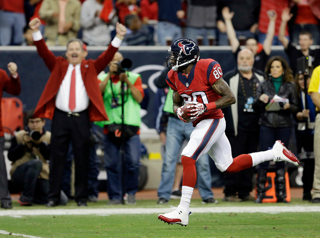 . Houston Texans\' Andre Johnson runs for a touchdown after making a reception during the first quarter of an NFL football game against the Indianapolis Colts, Sunday, Nov. 3, 2013, in Houston. (AP Photo/David J. Phillip)