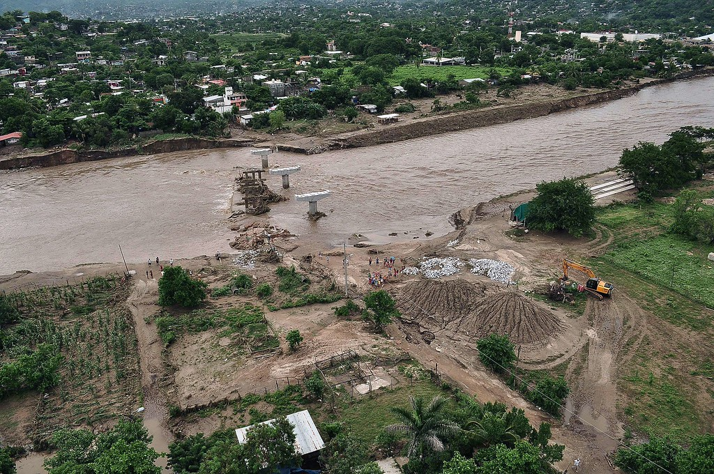 . Aerial view of a bridge swept away by heavy rains in Acapulco, Guerrero state, Mexico on September 17, 2013. The official death toll rose to 47 after the tropical storms, Ingrid and Manuel, swarmed large swaths of the country during a three-day holiday weekend, sparking landslides and causing rivers to overflow in several states.  AFP PHOTO / Claudio VARGAS/AFP/Getty Images