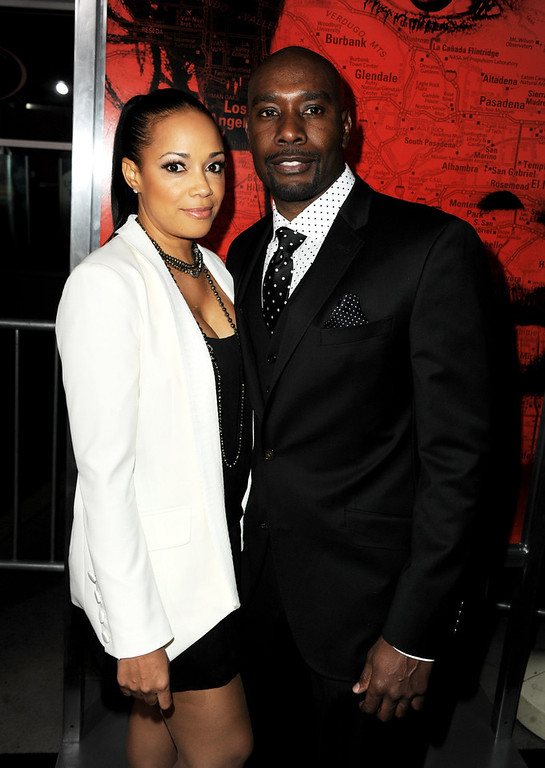 """. Actor Morris Chestnut (R) and his wife Pam Byse arrive at the premiere of Tri Star Pictures\' \""""The Call\"""" at the Arclight Theatre on March 5, 2013 in Los Angeles, California.  (Photo by Kevin Winter/Getty Images)"""