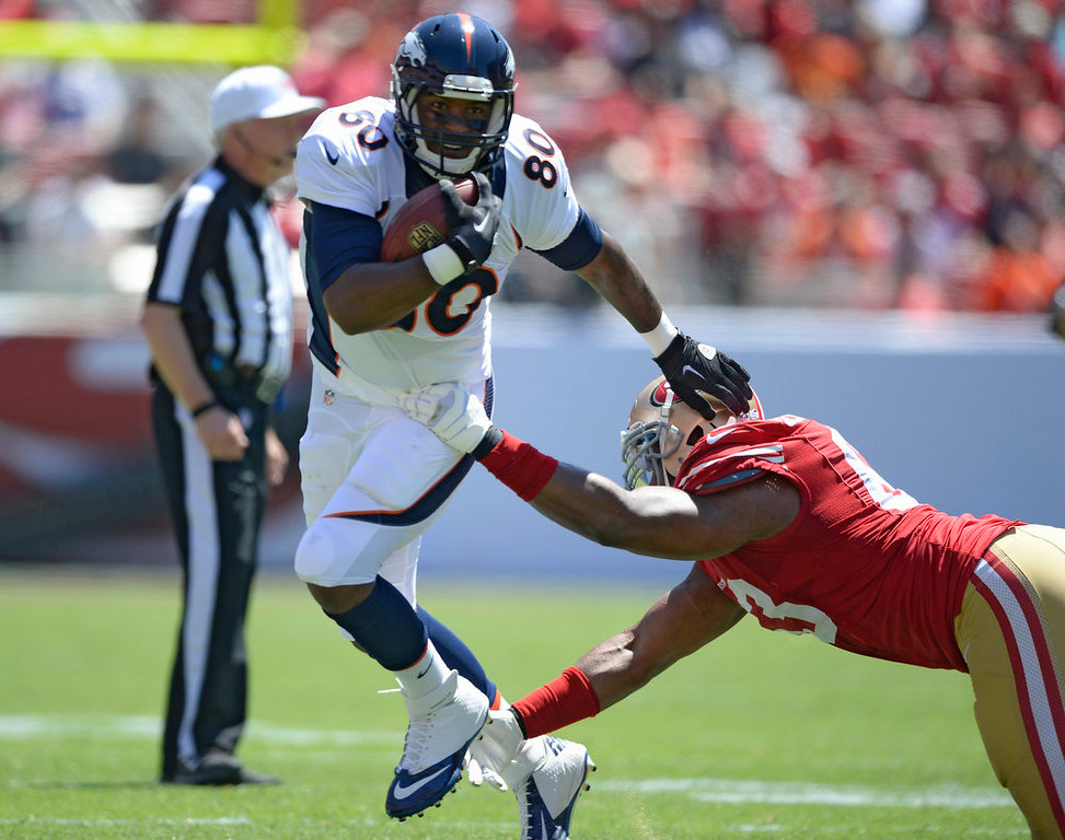 . Denver Broncos tight end Julius Thomas (80) gets tripped up by San Francisco 49ers Tony Jerod-Eddie (63) August 17, 2014 at Levi\'s Stadium. (Photo by John Leyba/The Denver Post)
