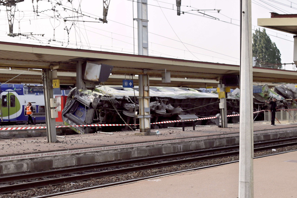 ". A picture shows a derailed wagon on the site of a train accident in the railway station of Bretigny-sur-Orge on July 12, 2013 near Paris. dent that caused ""many casualties\"", authorities said. AFP PHOTO /KENZO TRIBOUILLARD/AFP/Getty Images"